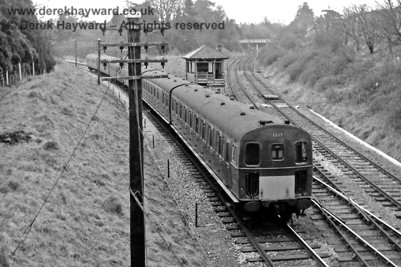 1317, in green livery, brings up the rear of the 12:09 service from Victoria, as it passes the site of St Margaret's Junction on 03.04.1969.  Eric Kemp retains all rights to this image.