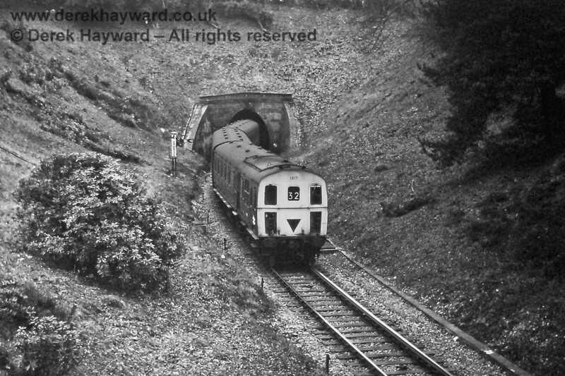 1317 passes the Distant signal for Grove Junction as it leaves the single bore Grove Tunnel with an Uckfield to Tonbridge train on Sunday 14.03.1976.  The train had left Tunbridge Wells West at 15:08.  (Colour image rendered in black and white).  Eric Kemp retains all rights to this image.