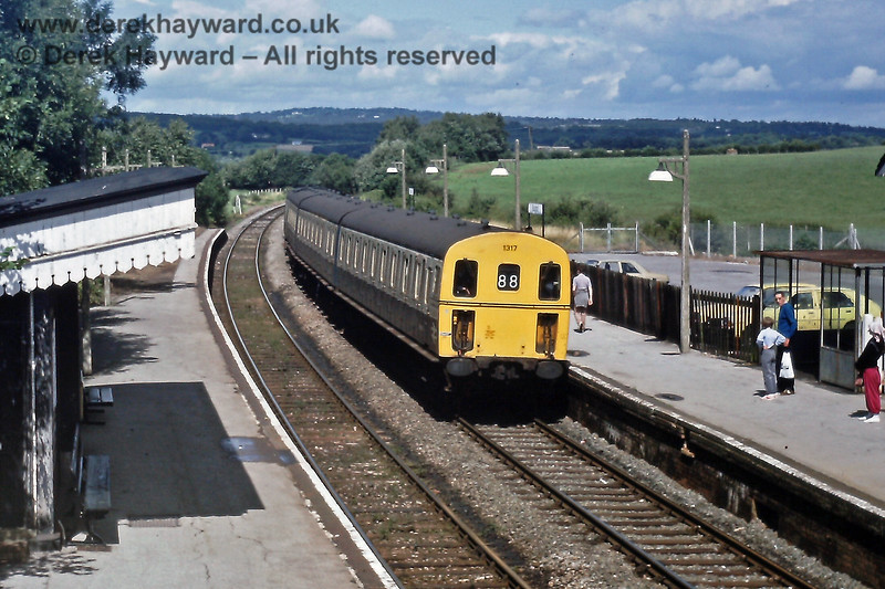 1317 at Buxted on the Uckfield portion of the 12:24 from Victoria.  Saturday 10.08.1985.  Note that Buxted then had two platforms.  Eric Kemp retains all rights to this image.