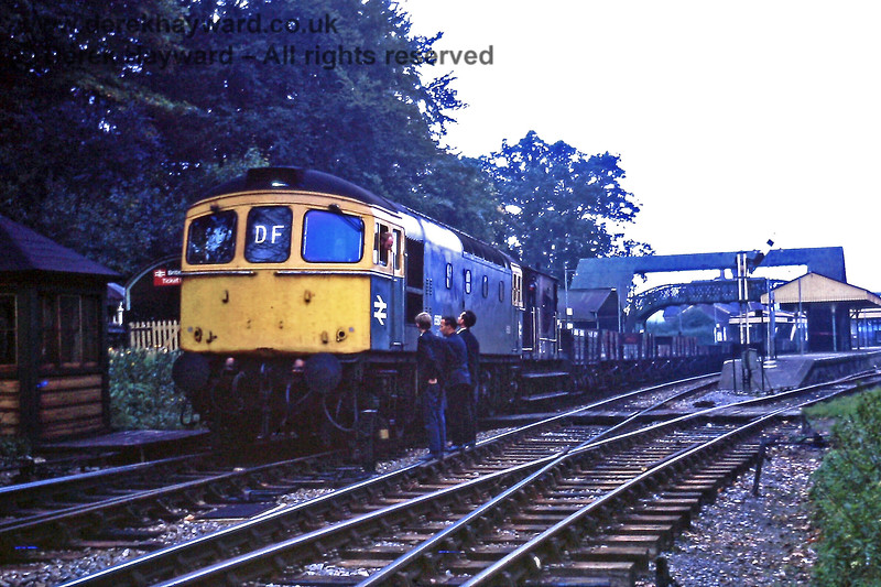 """6583 at Lingfield with the 10:20 Newhaven to East Grinstead freight on Saturday 10.10.1970.  The train was to be used on engineering works at Dormans the next day and had been shunted to the Up line to allow the 14:09 from Victoria to go past.  Nowadays it is not generally advised that three people not wearing high-viz should engage in conversation with the driver whilst standing on a track upon which a train is signalled to pass.  """"Please don't try this at home"""".  Eric Kemp retains all rights to this image."""