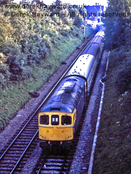 6585, having run round set 70, draws the stock to the Up main line at East Grinstead.  It will then set back into the sidings south of the station. 30.07.1971.  Eric Kemp retains all rights to this image.