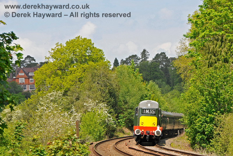 """D8188 approaching Forge Farm Crossing. On the left is """"Glen Andred"""" a fine home built in 1867 and designed by architect Norman Shaw.  Shaw also (amongst other things) designed the 1887 Scotland Yard buildings, which are now used by the UK Parliament. 29.05.2021 20578"""