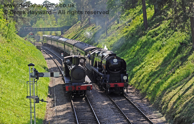 2890 stands in the cutting west of Groombridge as 34053 passes with a service train. 30.05.2021 18133