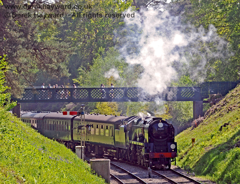 A crowd of admirers watch from the bridge as 34053 approaches Groombridge. 30.05.2021 18127