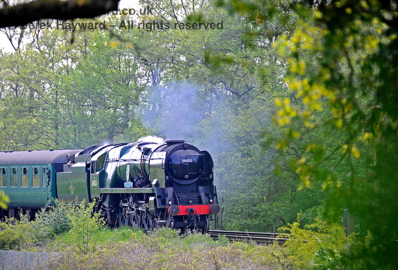 A glimpse through the bushes of 34053 approaching Forge Farm Crossing. 29.05.2021 18001