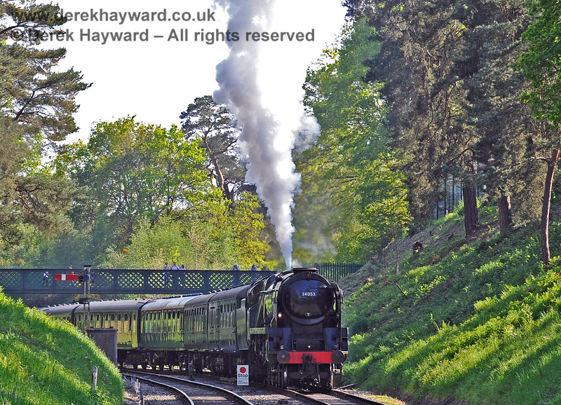 People watch from the bridge as 34053 blows off on the approach to Groombridge. 29.05.2021 18072