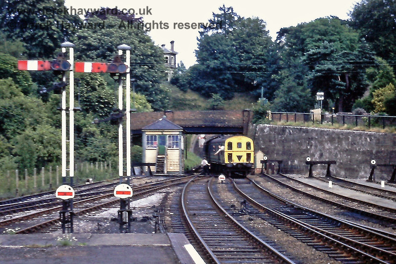 A nice view of the signals at the eastern end of Tunbridge Wells West as, in the background, the driver of 1308 surrenders the Grove Junction to Tunbridge Wells West single line token to the signalman at the 'B' signal box. Saturday 18.07.1970.  Eric Kemp retains all rights to this image.