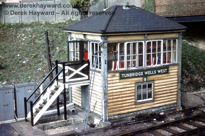 """Tunbridge Wells West 'B' Signal Box, pictured in April 1976, complete with a new set of steps.  A few days after the line closed on 7 July 1985 the """"B"""" signal box was destroyed by fire.  Despite this, enthusiasts recovered the blackened lever frame to Groombridge for restoration, together with the lever frame from the """"A"""" box.  However, very unfortunately, the frame from """"A"""" box was was stolen from storage shortly afterwards.  A very unhappy sequence of events for all concerned.  Eric Kemp retains all rights to this image."""