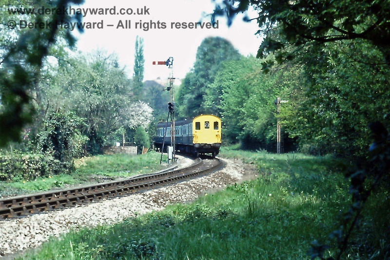 Hastings unit 1031 leaves Grove Junction with the empty coaching stock of the 12:45 from Charing Cross on Sunday 09.05.1976.  The train had terminated at Tunbridge Wells Central due to engineering works between Grove Junction and Wadhurst.  The heavily offset Distant signal on the right had almost disappeared in the trees, somewhat negating the sighting advantages of placing it there...!  Eric Kemp retains all rights to this image.