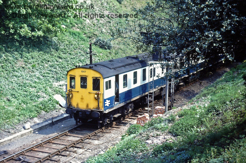 Hastings unit 1007 enters Tunbridge Wells West with the empty coaching stock of the 11:45 from Charing Cross on Sunday 09.05.1976. The train had terminated at Tunbridge Wells Central due to engineering works, and would reverse in the West station for it's return journey later.  Unit 1007 was one of the two units involved in the tragic accident at Hither Green on 5 November 1967, and was reformed after the accident, partially with surviving stock from 1007 and 1017.  Eric Kemp retains all rights to this image.