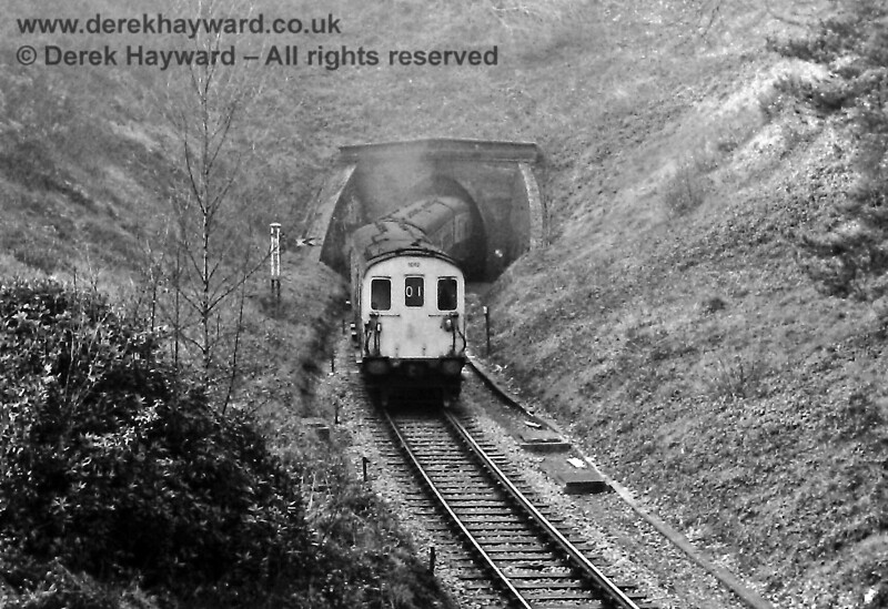 """1012 and 1011 heading east from Tunbridge Wells West (after refuelling there) and emerging from the eastern end of Grove Tunnel.  The train is passing the Grove Junction fixed Distant signal. Sunday 23.02.1975.  """"Grove Tunnel"""" is not to be confused with """"Grove Hill Tunnel"""" which is at the southern end of Tunbridge Wells Central station (and it does often cause confusion...).  Eric Kemp retains all rights to this image."""