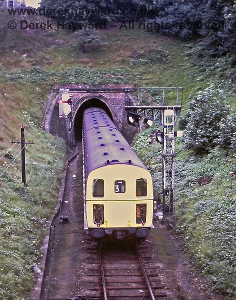 1310 emerges from the western portal of the single bore Grove Tunnel and enters Tunbridge Wells West on Saturday 19.08.1972.   Eric Kemp retains all rights to this image.