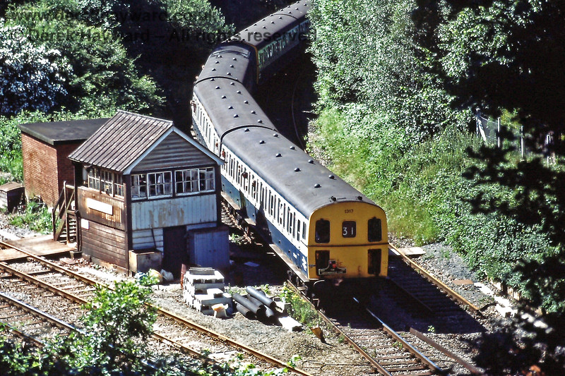 """Grove Junction on Saturday 06.07.1985, which was the last day of services on the line.  1317 and 1311 are working """"wrong line"""" into Tunbridge Wells Central with the 09:59 service from Eridge.  The train was terminating in the station owing to engineering works, and not going on to Tonbridge.  Eric Kemp retains all rights to this image."""