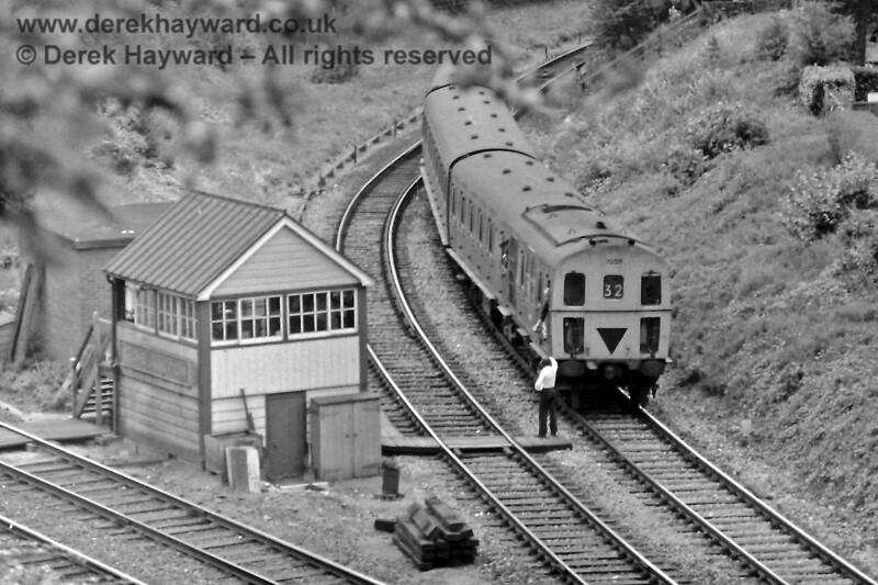 1308 leaves the single line at Grove Junction with the 12:08 service from Uckfield to Tonbridge on Sunday 08.08.1976.  The signalman is on the board crossing and about to collect the token from the driver.  Eric Kemp retains all rights to this image.