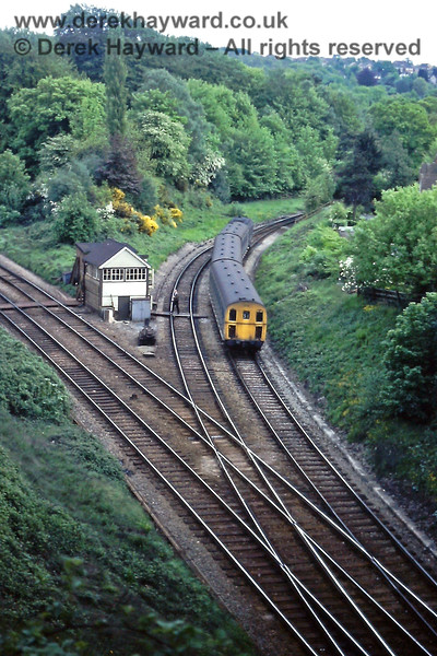 """A wide shot of Grove Junction on Wednesday 19.05.1976.   1309 is on the 16:34 Eridge to Tonbridge service and the signalman is on the board crossing having just collected the single line token from the driver.  The train is about to enter """"Grove Hill Tunnel"""" which is at the southern end of Tunbridge Wells Central station (not to be confused with """"Grove Tunnel""""). <br />  Eric Kemp retains all rights to this image."""