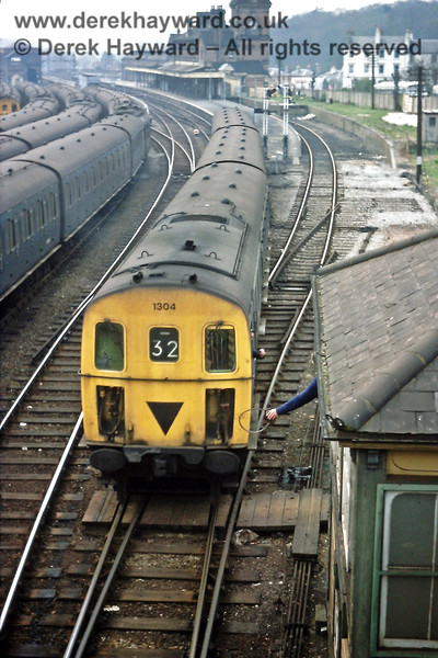 The driver of 1304, on the 16:08 Uckfield to Tonbridge service, collects the single line token from the signalman at Tunbridge Wells West 'B' signal box. Good Friday, 16.04.1976.  Eric Kemp retains all rights to this image.