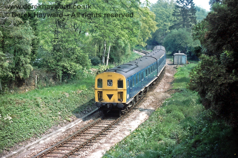 1303 amongst the trees between Grove Junction and Tunbridge Wells West with the 11:58 from Tonbridge.  Sunday 09.05.1976.  Eric Kemp retains all rights to this image.