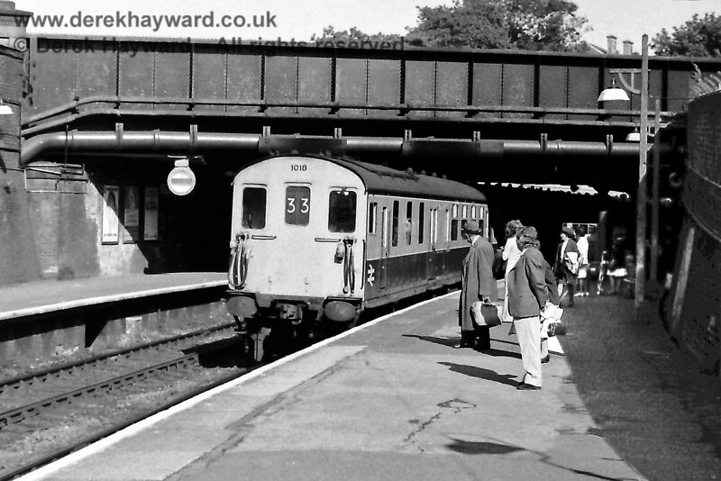 """1018 and (at the rear) 1012 arrive at Tunbridge Wells Central on a fast service from Cannon Street to St Leonards and Hastings. (09:44 from Orpington). Tuesday 17.09.1974.  In those years the majority of Hastings trains ran to and from Charing Cross, but there were also peak hour services to Cannon Street, of which this would be a back working.  It was also common for the train to split at Tunbridge Wells, with the front six coaches forming a semi-fast to Hastings and the rear six coaches forming an """"all stations"""" service.  Eric Kemp retains all rights to this image."""