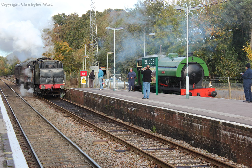 With autumn colours prevalent in the trees behind, 44422 makes history at Eridge