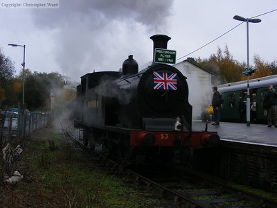 In the gloom, the M7 runs onto the front of the train to Tunbridge Wells West