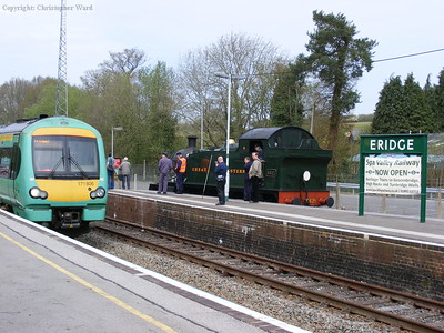 An Uckfield train passes the waiting Prairie