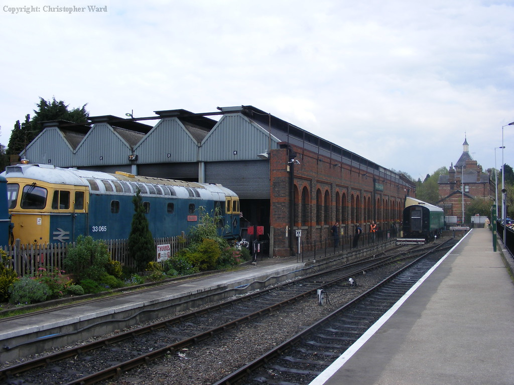 33065 outside the shed with the old station in the background