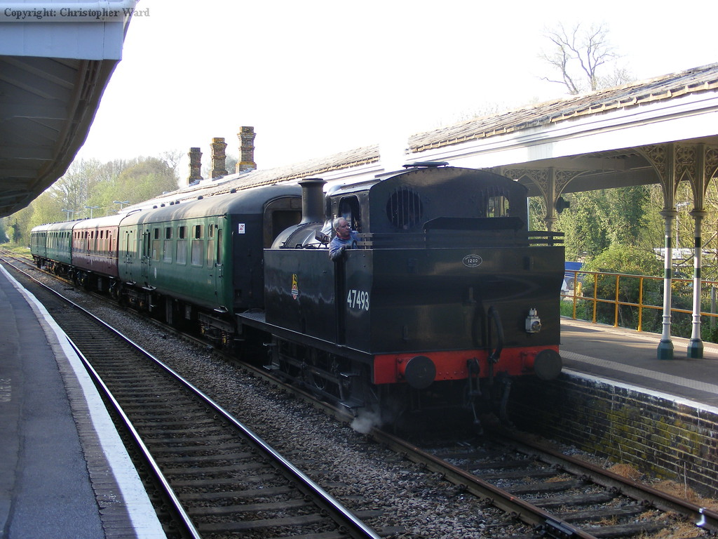 47493 brings the train to a stand