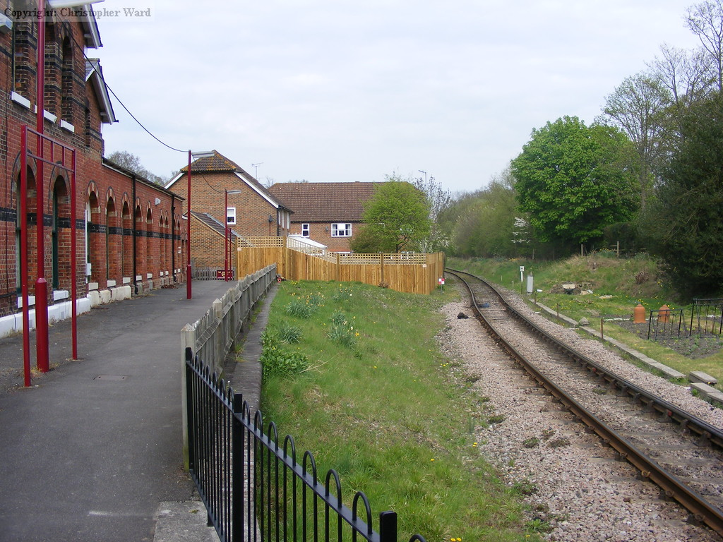 A photo displaying the alteration to the track layout required at Groombridge due to the new housing built, the platform edging runs stright in front of the camera