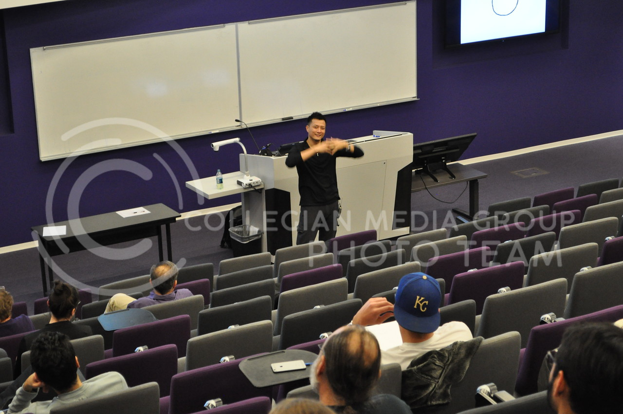 """Jorge Cham, co-producer of the YouTube channel, Piled Higher and Deeper, and comic artist, speaks to students in the Fiedler Hall Auditorium Oct. 31, 2017 about the importance of writing papers and getting them peer-reviewed during his presentation, """"The Space Gap."""""""