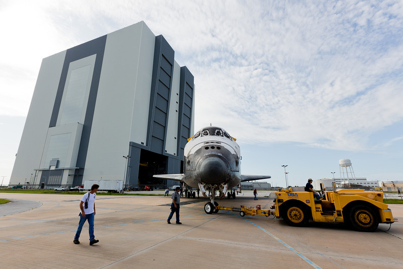 At Kennedy Space Center space shuttles Atlantis and Endeavour come nose to nose for the final time as they swap places between the Vehicle Assembly Building and Orbiter Processing Facility 2. Atlantis, which had been stored in the highbay since last month will finish up transition and retirement processing in the OPF before she is eventually rolled to the Kennedy Space Center Visitor Complex for display this fall. With aerodynanic tailcone installed, Endeavour has had all transition & retirement activities completed, she will sit inside the VAB until eventually being flown to Los Angeles, CA for display in mid-Sepember.