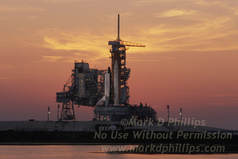 Space Shuttle Discovery on Pad 39 at Kennedy Space Center in Florida the night before launch with a blazing sunset. STS-29 was the 28th Space Shuttle flight and the 8th by Discovery. It took off from Launch Pad 39-B on March 13, 1989 at 9:57:00 a.m. EST. It landed at Edwards AFB on March 18, 1989 at 6:35:51 a.m. PST. The main payload carried and placed into orbit was the Tracking and Data Relay Satellite.