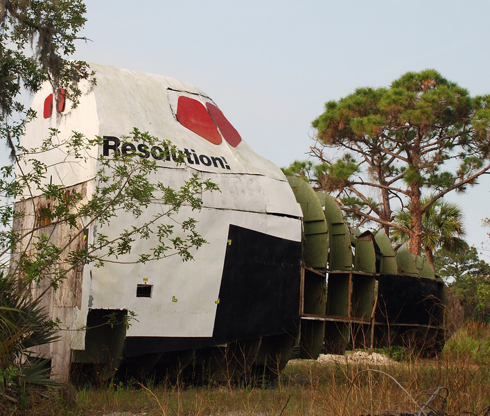 A wood and fiberglass mockup of the space shuttle built by private persons, it was transported by rail from California and now resides in a field just past the security gate at KSC.