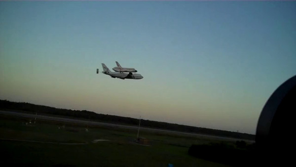 The pilot performs a very low fly by of the runway, then climbs up and out for the final flight of Shuttle Discovery