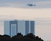 Discovery flies over the VAB (vehicle assembly building)