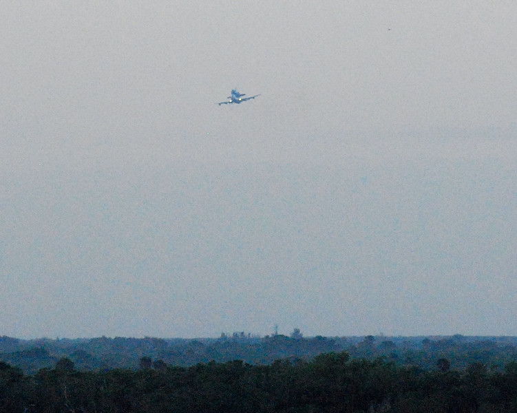 The 747 with Discovery returns toward KSC after flying over Titusville, FL.