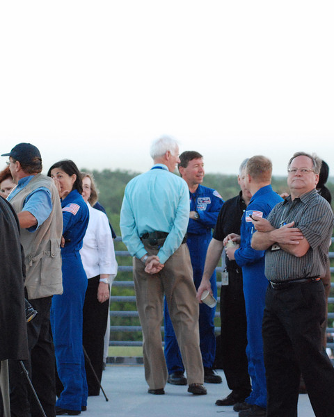 Astronaut Nicole Stott, (in blue jumpsuit on left) appears to be wiping tears after Discovery leaves. It was a solemn event for NASA employee`s and astronauts, as it means the Space Shuttle Program has truly ended.