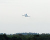 Discovery inbound for a very low level fly by of the runway and crowd.