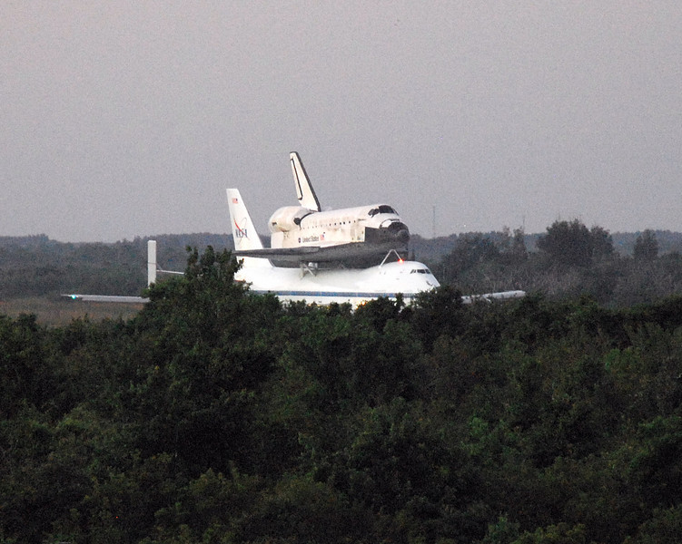 Discovery is taxied slowly down to stop in front of the tower before preparing to depart.