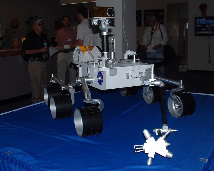 """A scale model of the Mars Rover """"Curiosity' on display inside the NASA press facility."""