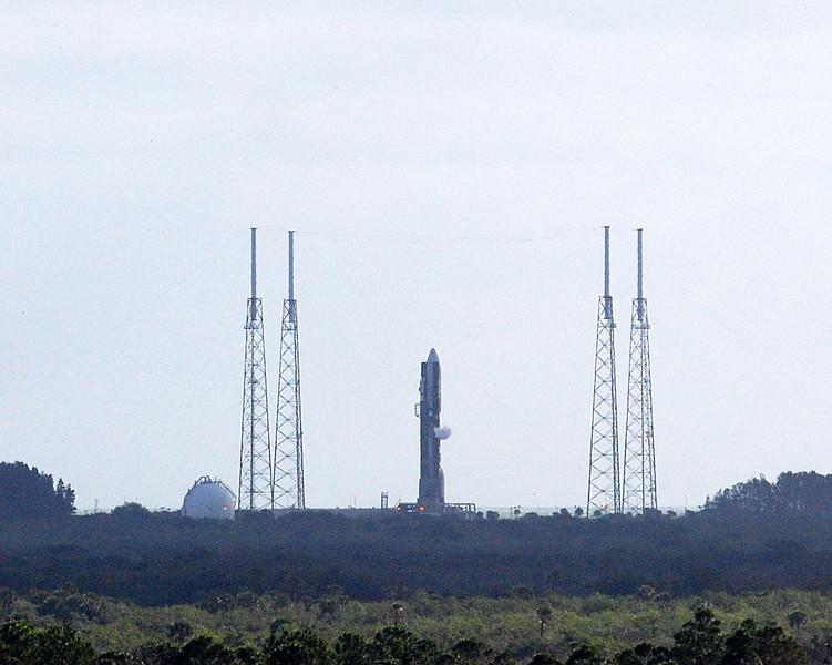 "MSL (mars science laboratory) rover ""curiosity"" sit atop an Atlas V rocket on pad 41."