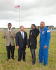 Astronaut Leland Melvin, Black Eyed Peas singer Will. I. Am., Yves LaMouth, and an unidentified man speak just prior to the launch.