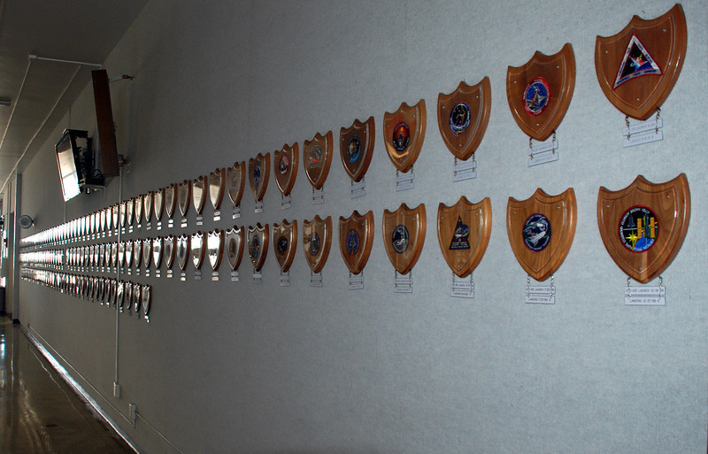 These are plaques displaying the mission badges of every shuttle mission, they are hung in the main entrance to the LCC building.