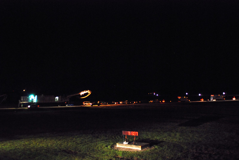 These are some of the many vehicles that surround the shuttle after landing to transport the crew and make the shuttle safe, various gas and liquids must be removed from the shuttle before it is returned to the recovery complex. This photo from the press viewing stand overlooking the runway at KSC.