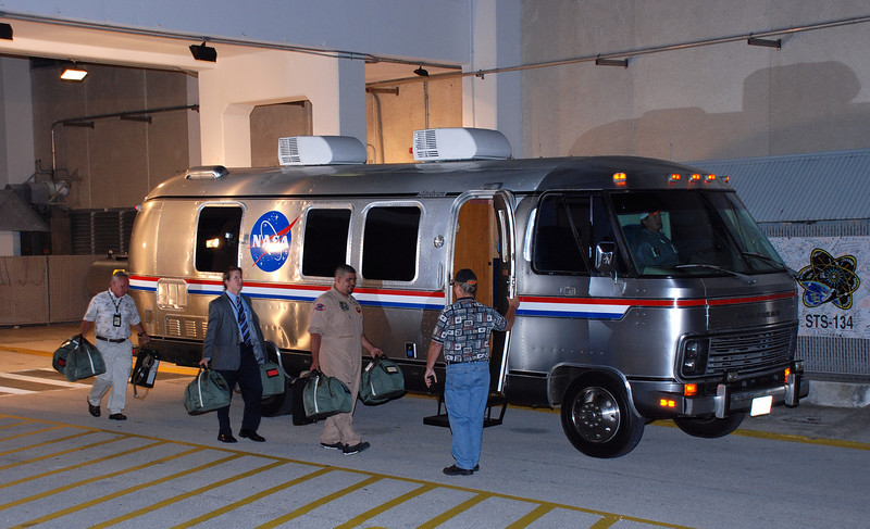Shuttle crew helmets and gloves are loaded into the transport vehicle
