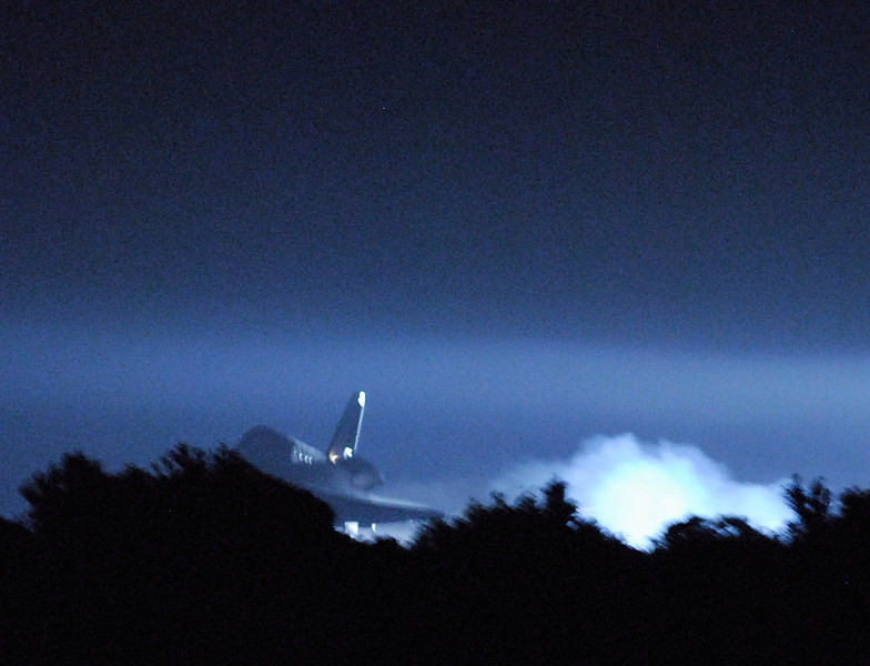 Space Shuttle Endeavour, STS-134 lands for the last time before being retired and put on display in California. This photo taken at 2:35 a.m. from the press viewing area at a distance of roughly 1/2 mile away.
