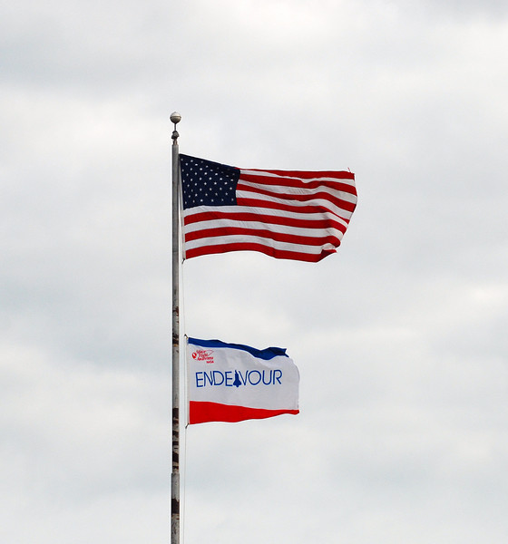 Mission Flag flies over the press area