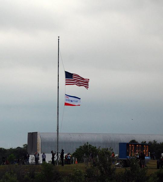 Mission flag being raised.