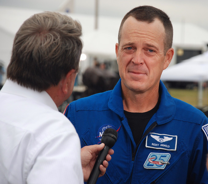 Astronaut  Arnold being asked for his thoughts about the shuttle program ending, his expression says it all.