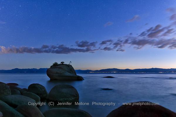 Clouds, Stars and Twinkling Lights at Lake Tahoe's Bonzai Rock