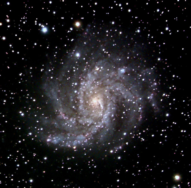 NGC6946: Also known as the Fireworks Galaxy, located just 10 million light-years away, behind a veil of foreground dust and stars in the high and far-off constellation of Cepheus. From our vantage point in the Milky Way Galaxy, we see NGC 6946 face-on. The galaxy's colors change from the yellowish light of old stars in the core to young blue star clusters and reddish star forming regions along the loose, fragmented spiral arms. NGC 6946 is bright in infrared light and rich in gas and dust, exhibiting a furious rate of star formation. Nearly 40,000 light-years across, the nearby spiral is fittingly referred to as the Fireworks Galaxy. Over the last 100 years, at least nine supernovae, the death explosions of massive stars, were discovered in NGC 6946. By comparison, the average rate for supernovae in the Milky Way is about 1 per century.